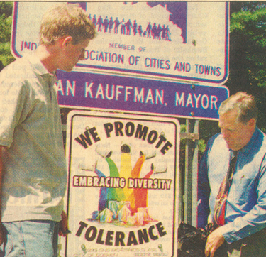 """In June 2000 Goshen Mayor Allan Kauffman, right, and Tim Shenk unveiled one of four """"We Promote Tolerance"""" signs at the city limits. Shenk, son of the author, was a student in a 1999 Goshen High School Bioethics class that focused on diversity. He did the artwork and led efforts by class members to receive approval to create and place the four signs, which then graced major city entryways for more than a decade. — Photo by Goshen News"""