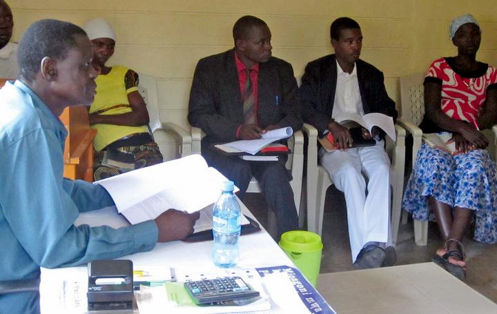 Bishop Albert Randa teaches church polity to candidates for ordination in the Tanzanian Mennonite Church in Mwanza. — EMM