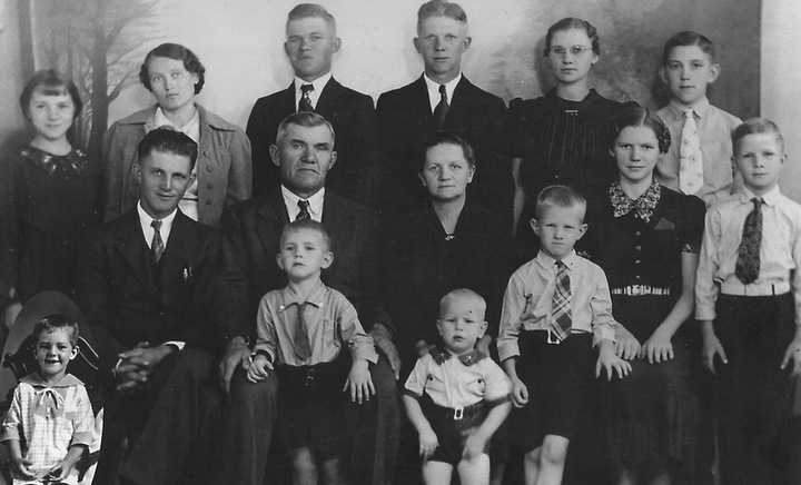 The Friesen family: back row, Martha, daughter-in-law Hannah, Jake, John, Esther and Calvin; second row, Arthur, Jacob, Kathrina, Ruth and Herb; front row, David, Paul, Marvin and Franklin. Nineof the  siblings attended Tabor. — Friesen family
