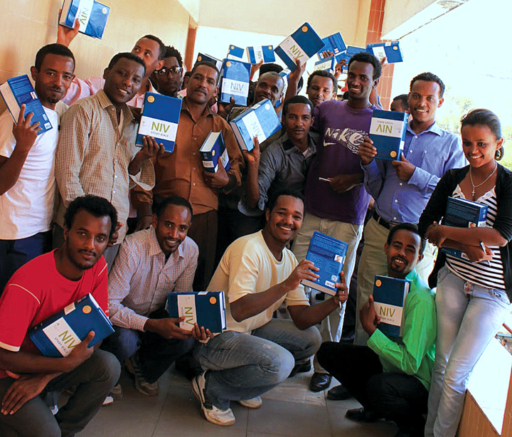 Students at Meserete Kristos College in Debre Zeit, Ethiopia, hold English Bibles from Listowel (Ont.)Mennonite Church. The congregation supplied a New International Version Study Bible to each first-year student in the theology program. The Ethiopian Anabaptist college does all of its theological education in English. — Norm Dyck/Mennonite Church Canada