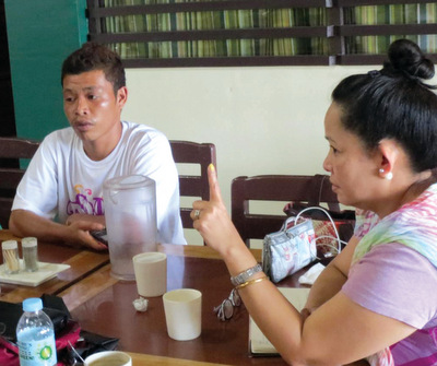 Joji Pantoja, right, confers with Dulangan Manobo tribal advocate John Calaba, who disappeared April 30 and is presumed murdered. — Peacebuilders Community Inc.