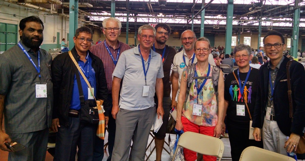 Reesor's friendship group stand together after morning worship on July 22,