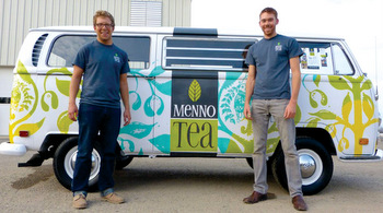Menno Tea co-founders Hans Weaver and Niles Graber Alvarez stand in front of the Menno Tea bus. They opened the Menno Tea Mint Farming Cafe July 20 in Bird-in-Hand, Pa. — Menno Tea
