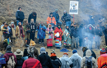 Protesters participate in a prayer circle on Thanksgiving Day during a protest against plans to pass the Dakota Access pipeline near the Standing Rock Indian Reservation, near Cannon Ball, N.D., Nov. 24. — Stephanie Keith/Reuters