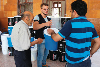 The Middle East Council of Churches distributed Mennonite Central Committee relief kits to the most vulnerable displaced people and host community members in an Aleppo neighborhood last summer. The kits contained hygiene supplies. — Middle East Council of Churches
