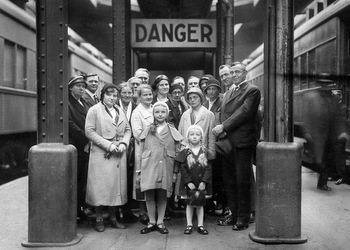 Mennonite newcomers to Canada at a train station in 1933. — Mennonite Heritage Centre Archives