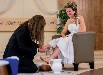 Benni Krauss and Rianna Isaak perform a footwashing ritual during their wedding on Aug. 19, 2017, at River East Mennonite Brethren Church in Winnipeg, Man.  — Matthew Veith