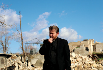 Ibrahim Nseir, pastor of the National Presbyterian Church of Aleppo, Syria, shows the rubble where his church once stood. He and his community have been encouraged by the prayers of people from around the world. — Emily Loewen/MCC