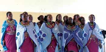Eighteen Maasai women from a Mennonite fellowship slept the night on the grounds of Nyamasaria Primary School in Kisumu, Kenya, to attend Renewal 2027 and perform a traditional dance. — Len Rempel/MWC