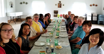 Mennonite Church USA Executive Board members and staff enjoy an Amish-style dinner at the home of Lavern and Barbara Miller. — Linda Dibble/MCUSA