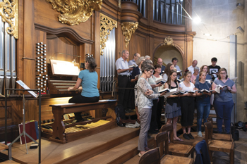 Members of Bern Mennonite Church sing at an opening ceremony of the Bern Stations Way Aug. 24 in Bern Minster, a Swiss Reformed cathedral. The path is a set of clues focused on the city's Anabaptist history.—Beat Loosli