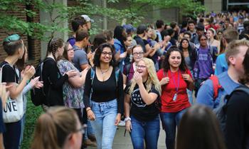 Goshen College students walk through an applause tunnel after opening convocation Aug. 29. — Brian Yoder Schlabach/Goshen College