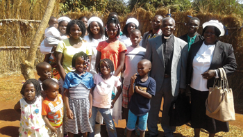 Brethren in Christ evangelist Laston Bissani Mitambo with his wife, Carlotta, and their family. — Mennonite World Conference