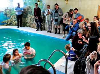 Seven women ages 16 to 22 were baptized at a pool when European leaders representing Mennonite World Conference visited Zaporizhzhia. — J. Nelson Kraybill/MWC