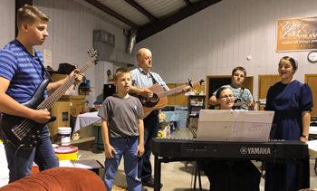 Brenten, Caleb, Dan, Pamela, Corey and Brianna Wiebe sing for MDS volunteers. — John Longhurst/MDS