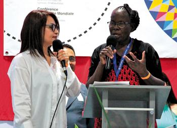 Rebecca Osiro of Kenya, with translator Sandra Baez, tells of Kenyan Mennonites' work with refugees in a predominantly immigrant neighborhood of Nairobi. — Henk Stenvers/MWC