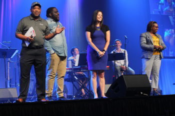 Mennonite Church USA executive director Glen Guyton, left, speaks July 2 at the opening worship service of the Mennonite Church USA convention in Kansas City, Mo. — Vada Snider/For MWR