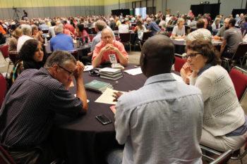 Delegates converse July 3 at the Mennonite Church USA convention in Kansas City, Mo. — Vada Snider/MWR
