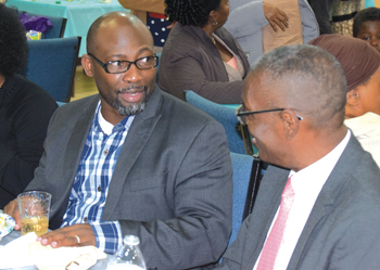 Omar Guzman, left, pastor of Evangelical Garifuna Church in Manhattan, talks last year with Celso Jaime, pastor of Evangelical Garifuna Church in Bronx in 2018.— Laurie Oswald Robinson for MWR
