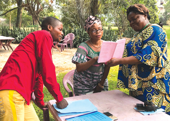 Yamba Katembue Patrice, Godelieve Tshikaya and Hélène José Mbombo study in Kinshasa during a train-the-trainers workshop. — Nancy Myers/Africa Inter-Mennonite Mission
