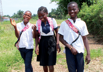 Sixth-graders Mayambi Mayambi, Luta Nguadi and Mputu Shayi return home from class in Tshikapa.— Kabamba Lwamba/MCC