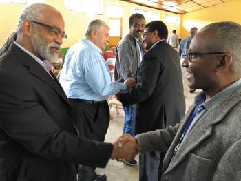 Former Meserete Kristos ChurchPresident Tewodros Beyene, right, greets LMCBishop Alvin Motley. — Glenn Kauffman/LMC