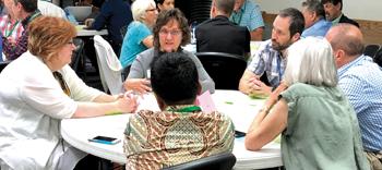 Constituency Leaders Council participants meet around tables at Trinity Mennonite Church in Glendale, Ariz. — Gordon Houser/The Mennonite