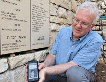 Bill Clemens holds a picture of his aunt, Lois Gunden, under her name at Yad Vashem Holocaust Remembrance Center in Jerusalem. — J. Nelson Kraybill