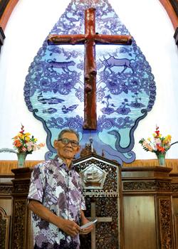 "Harjo Suyitno designed the ""cosmic Christ"" cross artwork in the Indonesian gunungan style at the Mennonite church in Jepara. — Karla Braun/MWC"