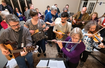 Musicians, in foreground from left, Merrill Miller, Alissa Bender, Perry Blosser, Rosene Rohrer and Andrea Weber Steckly accompany a song during the Worship and Music Leaders Retreat on Jan. 10-12 at Laurelville retreat center in Mount Pleasant, Pa. The retreat focused on new material from the Voices Together hymnal, to be released by Herald Press this fall. — Kreg Ulery