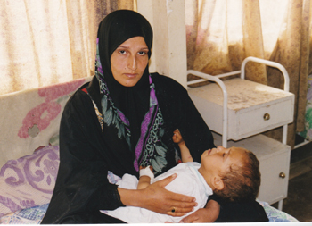 A mother and sick child in Baghdad, Iraq, suffer from sanctions in 1998. — Mel Lehman/Common Humanity