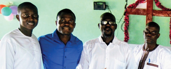 New pastors in Mennonite Church West Africa are Adriano MBackeh, Daniel Djin-ale, Gibby Mane and Sangpierre Mendy. — Beryl Forrester/EMM