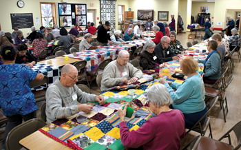 Despite snow and predictions for ice, volunteers from Lancaster County, Pa., and beyond came together Jan. 18 for the Great Winter Warm-up at the MCC East Coast Material Resources Center in Ephrata. The volunteers made 132 comforters that day. — Jim Wiegner/MCC
