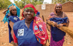 In Kobiteye, a refugee camp in Chad, refugee Aïchatou Hamidou, center, leads the WASH team, a group of women who maintain the latrines and pumps constructed in the camp by MCC partner Secours Catholique et Développement (Catholic Relief Services). — Colin Vandenberg/MCC