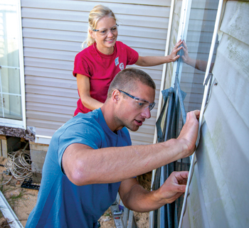 Curtis and Heather Funk of Winkler, Man., work on a house in Marianna, Fla., one of the Mennonite Disaster Service projects shut down due to COVID-19. — Paul Hunt/MDS