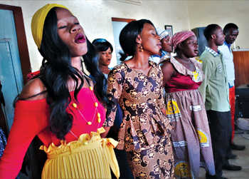 A choir at a Mennonite church in Ouagadougou, Burkina Faso, sings during the visit by a Deacons Commission delegation of Mennonite World Conference. — J. Nelson Kraybill/MWC