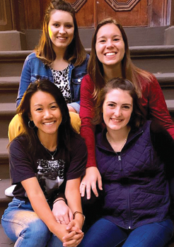 The Manhattan Mennonite Voluntary Service unit: back, Hannah Brown, Kylee Schunn; front, Anh Nguyen, Laura Ayres. — Mennonite Mission Network