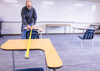 Lynn Veurink and other Eastern Mennonite University staff are working on campus modifications to implement new COVID-19 health and safety measures, such as ensuring social distancing in classrooms. — Rachel Holderman/EMU