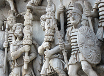 Roman soldiers in these second-century statues carry the kind of military standards with images of the emperors that devout Jews deemed idolatrous. — J. Nelson Kraybill