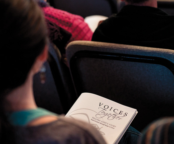 A participant sings from a Voices Together booklet during the annual Music and Worship Leaders Retreat at Laurelville retreat center in Mount Pleasant, Pa., in 2019. — Heike Martin