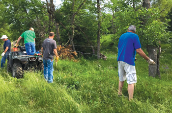 A Mennonite Disaster Service volunteer team from Milford and Wood River, Neb., rebuilds fencing June 6 near Spencer, Neb., after Boyd County experienced heavy flooding in March 2019. — Mennonite Disaster Service