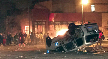 A postal service van burns in front of the Minneapolis Police Department's Third Precinct station in the early morning hours of May 29. — Candace Lautt