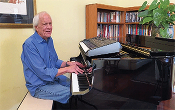Ken Medema performs a new song he wrote for the Church of the Brethren on July 2. — Church of the Brethren