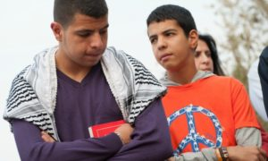 Palestinian Christian youth attend a prayer service as a nonviolent witness against the Israeli separation barrier in the West Bank town of Beit Jala, November 2, 2012. If constructed as planned, the barrier would cut off a monastery and agricultural lands belonging to Beit Jala.