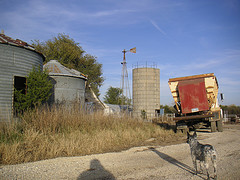 Behind the grain bins