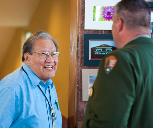 Lawrence Hart (left) greets Alden Miller, Superintendent at Sand Creek National Historic Site. Photo by the National Park Service