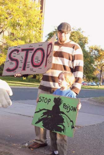 Mark and his son Jonas protest fracking. Photo by Josh Miller