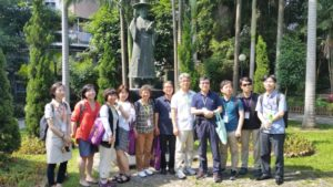 Korean participants stand under the statue of St. Taegeon Andrew Kim (photo by Chris Rice)