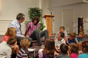 Femi tells the children's story at his congregation, Waterford Mennonite Church in Goshen, Ind. Photo by Dee Birkey.