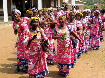 A choir welcomes visitors arriving to celebrate the 2012 centennial of Mennonites in the Democratic Republic of Congo. Africa produced some of the greatest successes in Mennonite missions. As national churches matured and grew, the Global South claimed the Mennonite majority. — James Krabill/MMN